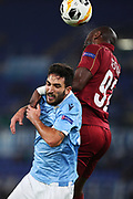 Danilo Cataldi of Lazio (D) goes for a header with Cestor Mike of Cluj (U) during the UEFA Europa League, Group E football match between SS Lazio and CFR Cluj on November 28, 2019 at Stadio Olimpico in Rome, Italy - Photo Federico Proietti / ProSportsImages / DPPI