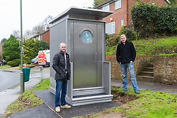 Local residents Cliff Neville, 33, and Richard Trebell, 41 examine the vandalism caused to a bus drivers' toilet that  suddely appeared on the corner of Melody Road and Whitby Close in Biggin Hill, Kent. Biggin Hill, Kent, December 06 2018.