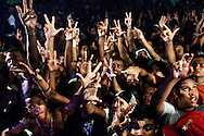 """Baile"" of Furacão Tsunami, the most powerful soundsystem on the Funk scene in Rio. Club Boqueirão, downtown Rio de Janeiro . Every hand gesture has a meaning : 3 fingers apart mean ""Vida louca"" (crazy life), the C and V letters symbolize the Commando Vermelho, the principal drug faction in Rio's favelas."