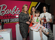 "Trisha Yearwood, left, Emmy Rossum, center, Eva Chen, right, and Sydney ""Mayhem"" Keiser, seated center, are celebrated as Barbie Sheroes with their one-of-a-kind doll at the Variety Power of Women event, Friday, April 24, 2015, in New York.  The first ever Barbie Shero awards celebrate women who are inspiring girls.  (Photo by Diane Bondareff/Invision for Barbie/AP Images)"