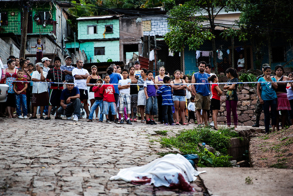 Tegucigalpa, Honduras<br /> Hector &quot;Bacon&quot; Andres, 28, is a taxi driver. He was on a memorial service for a friend that was killed the day before. Hector was shoot in the street at 6 am. Three men has been shoot in the same street the last two days. &rdquo;This is how people are killed in Honduras. Like dogs. The murderer will never be found&rdquo;, says he&acute;s wife.