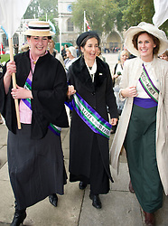 "UK Feminista photocall. 'Suffragettes' to descend on Parliament to lobby MP's for ""urgent action"" om women's equeslity.  Dr. Helen Pankhurst, Granddaughter of suffragette leader Sylvia Pankhurst (centre) seen with other demonstrators on Parliament Square outside the House of Commons, Wednesday October 24, 2012. Photo By i-Images"