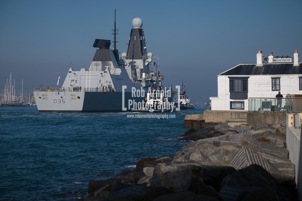 HMS Dragon sails into her home port of Portsmouth for the first time in two months.  The Type 45 destroyer has been on a deployment involving exercises with the U.S. Navy and also a visit to the British Overseas Territory of Gibraltar.