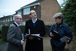 © Licensed to London News Pictures . 17/11/2014 . Kent , UK . UKIP candidate Mark Reckless (centre) and UKIP deputy leader Paul Nuttall (left) canvassing votes in Strood in the Rochester and Strood by-election . They meet Fatima Macaulay (right) who says she's voting UKIP . Photo credit : Joel Goodman/LNP
