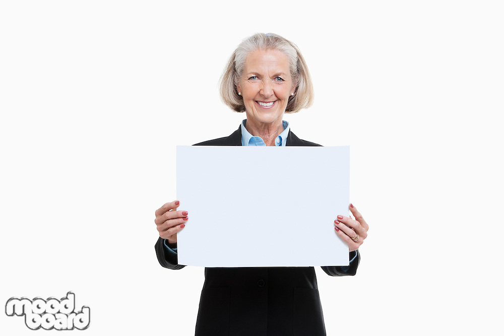 Portrait of senior woman holding blank board against white background