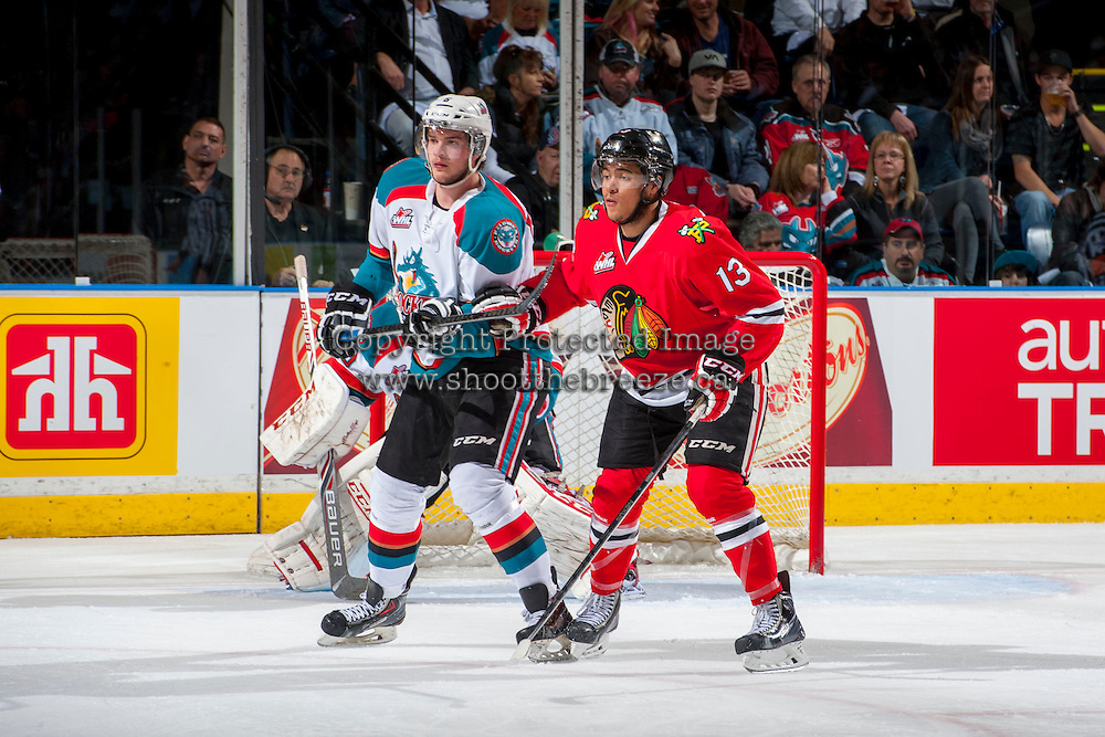 KELOWNA, CANADA - APRIL 18: Keegan Iverson #13 of the Portland Winterhawks checks Mitchell Wheaton #6 of the Kelowna Rockets on April 18, 2014 during Game 1 of the third round of WHL Playoffs at Prospera Place in Kelowna, British Columbia, Canada.   (Photo by Marissa Baecker/Shoot the Breeze)  *** Local Caption *** Keegan Iverson; Mitchell Wheaton;