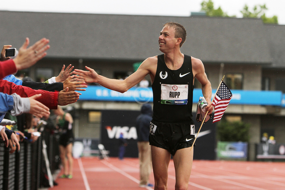 Galen Rupp greets fans trackside on victory lap after winning 10,000 meters