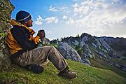 Tipu, watches the sunset while sipping lemon tea at Kalabagh, near Churdhar, Himalayas, India