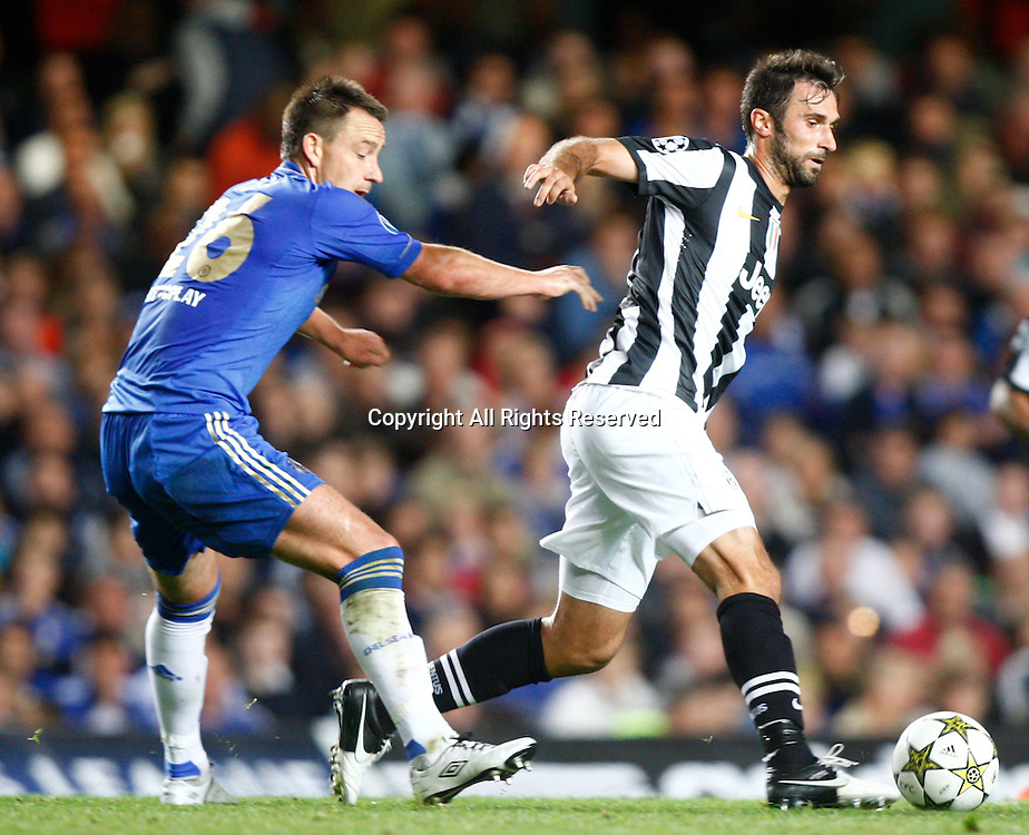 19.09.12 London, ENGLAND: <br /> John Terry of Chelsea  and Mirko Vucinic of Juventus F.C.<br /> during the UEFA Champions League Group E match between Chelsea and  Juventus at Stamford Bridge Stadium