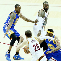 07 June 2017: Cleveland Cavaliers forward LeBron James (23) passes the ball to Cleveland Cavaliers guard Kyle Korver (26) past Golden State Warriors forward Andre Iguodala (9) and Golden State Warriors guard Ian Clark (21) during the Golden State Warriors 118-113 victory over the Cleveland Cavaliers, in game 3 of the 2017 NBA Finals, at  the Quicken Loans Arena, Cleveland, Ohio, USA.