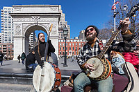 NEW YORK CITY- MARCH 26, 2018 : Musicians palying in front of Washington Square one of the main Manhattan Landmarks