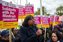 © Licensed to London News Pictures. 30/04/2018. London, UK. Shadow Home Secretary DIANE ABBOTT (centre) speaks to protesters in Parliament Square about the ongoing Windrush migrant scandal. Photo credit: Rob Pinney/LNP