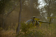 Hughes 500 Helicopter<br /> Majete Wildlife Reserve<br /> MALAWI, Africa<br /> Reserve proclaimed in 1955, is situated in the Lower Shire Valley, a section of Africa's Great Rift Valley, covering an area of 700 km?. Vegetation is diverse, ranging from moist miombo woodland to dry savannah.Hughes 500 helicopter (Pilot Barney O'Hara)<br /> Chopper used as a darting platform while testing buffalo for foot-and-mouth disease in a trans-border veterinary effort.