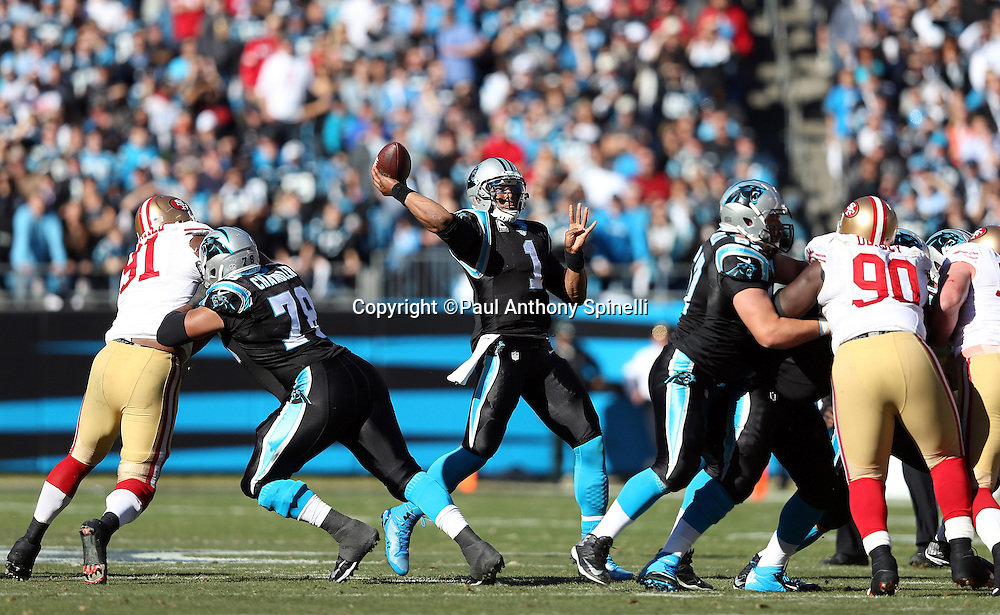 Carolina Panthers quarterback Cam Newton (1) throws a pass during the NFC Divisional Playoff NFL football game against the San Francisco 49ers on Sunday, Jan. 12, 2014 in Charlotte, N.C. The 49ers won the game 23-10. ©Paul Anthony Spinelli