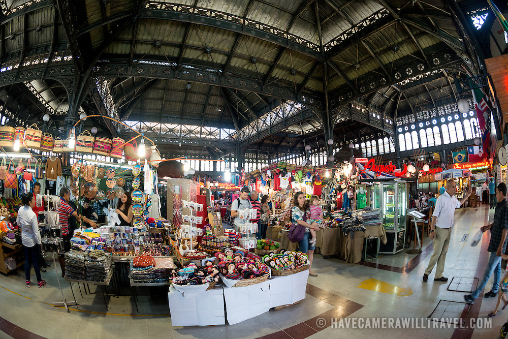The interior of Mercado Central de Santiago, Chile's central market. The market specializes in seafood, a staple food category of Chilean cuisine. The building is topped with an ornate cast-iron roof.