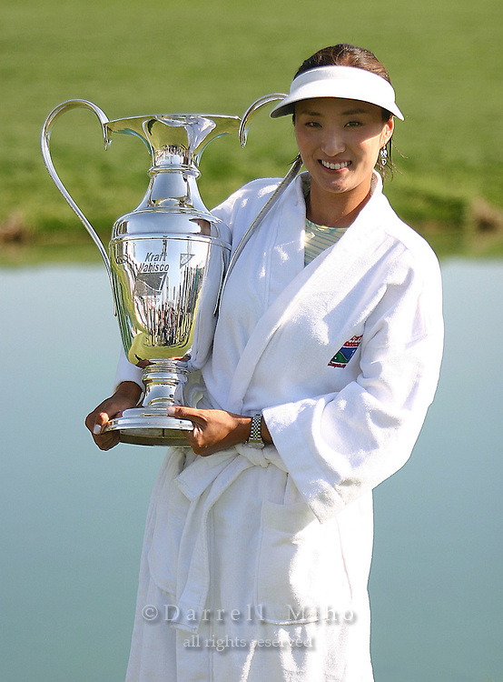 March 28, 2004; Rancho Mirage, CA, USA;  Grace Park poses with her trophy after the final round of the LPGA Kraft Nabisco golf tournament held at Mission Hills Country Club.  Park won her first major tournament by one stroke over Aree Song with an overall score of 11 under par 277.  She finished the day with a 3 under par 69.<br />Mandatory Credit: Photo by Darrell Miho <br />&copy; Copyright Darrell Miho