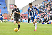 Wigan Athletic Forward, Yanic Wildschut causing more trouble for the the bury defence during the Sky Bet League 1 match between Wigan Athletic and Bury at the DW Stadium, Wigan, England on 27 February 2016. Photo by Mark Pollitt.