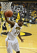 February 19 2011: Iowa Hawkeyes guard Bryce Cartwright (24) pulls down a rebound during the first half of an NCAA college basketball game at Carver-Hawkeye Arena in Iowa City, Iowa on February 19, 2011. Michigan defeated Iowa 75-72 in overtime.