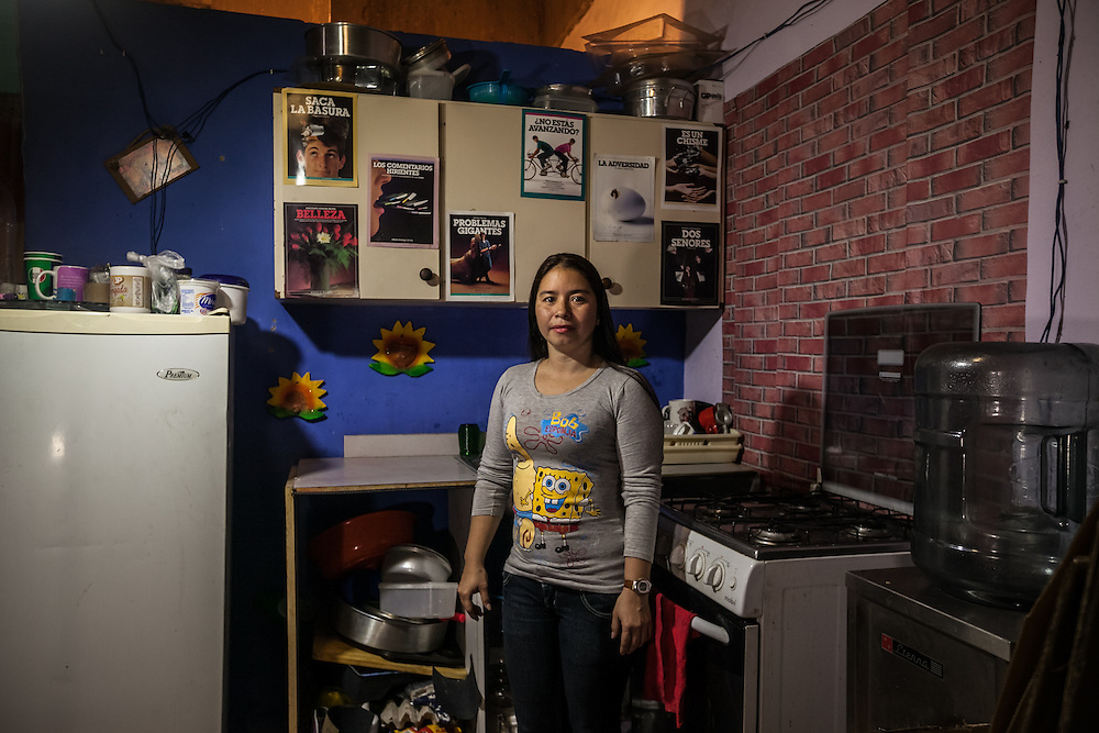 "Four years ago, after losing her job and struggling to make rent payments in a Caracas slum, single-mother Teresa del Carmen Medina, 39, scoffed when her mother suggested she join her to live inside the Tower of David. After seeing the small space her mother had suggested, she responded, ""I'm not going to live in that hole! you're crazy!"" She had heard rumors that the tower was dangerous and women were raped inside, and she feared for the safety of her teenage daughter. Teresa laughs at her old way of thinking now, standing inside her tidy, painted blue kitchen,  decorated with ceramic sunflowers and inspirational posters with catchy sayings to overcome adversity and not to think negtively or gossip. She works the night shift from 9pm until 8am as a waitress in a hotel. ""I chose the night shift to have time with my children in the mornings, then go to work while they sleep."" She says she used to work the day shift, but rarely got to see her children. ""I prefer to spend more time with them,"" she said. [Working the night shift] is a sacrifice to be able to be with my family.""  It was a struggle for Teresa to build her home here. She described buying construction materials little by little, first making the floor, then the walls for two bedrooms, then saving to install some tile in the bathroom. ""I built our house to be functional, so that there are not any obstacles for our family to unite."" Even though her space is small, they can all sit and eat together. ""At dinnertime, we always see each others faces."" Her daughter did her final high school project about discrimination against people who live inside the Tower of David, showing how the majority of residents are respectable people who work hard, but have trouble making ends meet. ""We live inside the tower out of need,"" Teressa said. ""I wish people would not judge us, not only look at the bad side…not judge us based on appearances. There is a lot of potential here between all of us.�"
