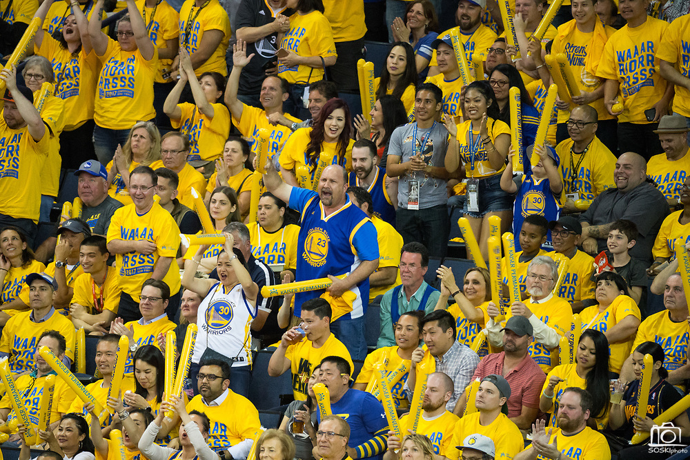 Golden State Warriors fans celebrate a win against the Utah Jazz during Game 1 of the Western Conference Semifinals at Oracle Arena in Oakland, Calif., on May 2, 2017. (Stan Olszewski/Special to S.F. Examiner)
