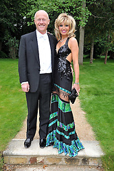 JOHN CAUDWELL and CLAIRE JOHNSON at the Raisa Gorbachev Foundation fourth annual fundraising gala dinner held at Stud House, Hampton Court, Surrey on 6th June 2009.