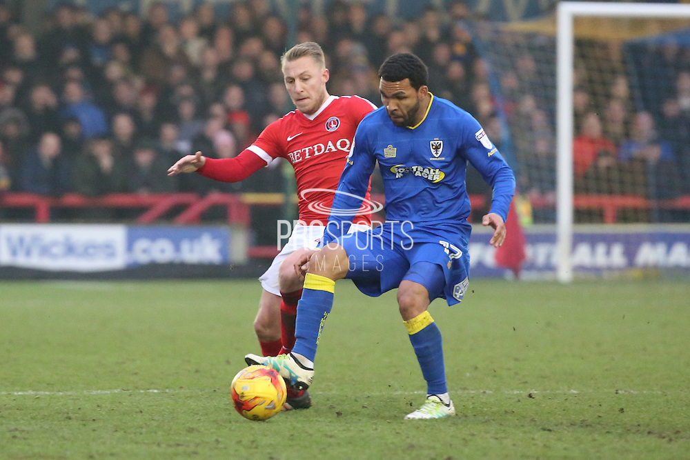 AFC Wimbledon striker Andy Barcham (17) battles for possesion with Charlton Athletic midfielder Chris Solly (20) during the EFL Sky Bet League 1 match between AFC Wimbledon and Charlton Athletic at the Cherry Red Records Stadium, Kingston, England on 11 February 2017. Photo by Matthew Redman.