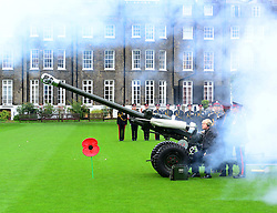 Boris Johnson Poppy Day gun salute. <br /> Boris Johnson, is joined by members of the armed forces and volunteers raising money for London Poppy Day, as he launches the annual event by firing a gun salute in front of Armoury House, at The Honourable Artillery Company, Armoury House, London, United Kingdom. Tuesday, 5th November 2013. Picture by Nils Jorgensen / i-Images