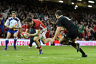 Alex Cuthbert of Wales dives over to score his sides 2nd try. Dove Men autumn international series, Wales v New Zealand at the Millennium stadium in Cardiff , South Wales on Saturday 24th November 2012. pic by Andrew Orchard, Andrew Orchard sports photography,
