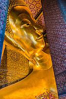 reclining buddha portrait at Wat Pho temple Bangkok Thailand