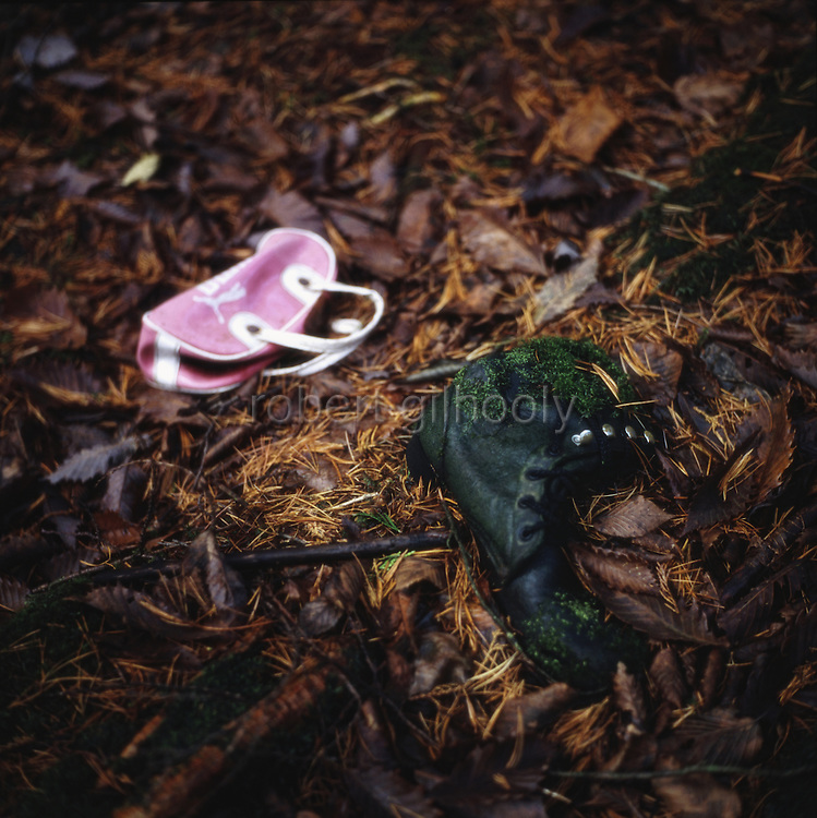 A boot and small bag lie in the undergrowth of Aokigahara Jukai, better known as the Mt. Fuji suicide forest, which is located at the base of Japan's famed mountain west of Tokyo, Japan on Dec 1 2009.