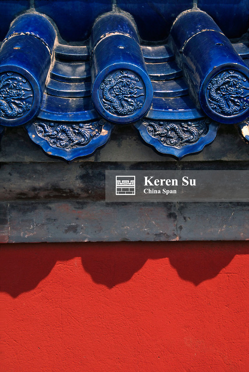 Blue glazed tiles with red wall in Forbidden City Beijing China