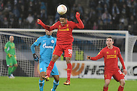Thu., Feb. 14, 2013, Russia, St. Petersburg. .Zenit St. Petersburg's Roman Shirokov, left, against Liverpool's Raheem Sterling in the UEFA Europa League's last 32 match..Kommersant Photo/Alexander Petrosyan