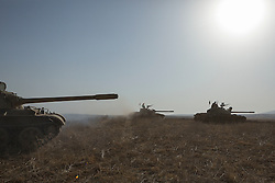 20/10/2016. Bashiqa, Iraq. Three Kurdish T-55 tanks advances as peshmerga fighters start a large offensive to retake the Bashiqa area from Islamic State militants today (20/10/2016).<br /> <br /> Launched in the early hours of today with support from coalition special forces and air strikes, the attack is part of the larger operation to retake Mosul from the Islamic State, and involves both the Kurds and the Iraqi Army. The city of Bashiqa, around 9 miles north of Mosul, is one of several gateway areas that must be taken before any attempted offensive on Mosul itself.<br /> <br /> Despite the peshmerga suffering several casualties after militants fought back using mortars, heavy machine guns and snipers, the Kurdish forces were quickly taking ground with Haider al-Abadi, the Iraqi prime minister, stating that the operation to retake Mosul was progressing faster than expected. Photo credit: Matt Cetti-Roberts/LNP