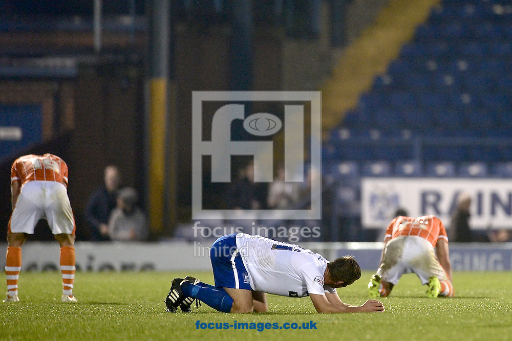 Bury and Blackpool players are exhausted following the Sky Bet League 1 match at Gigg Lane, Bury<br /> Picture by Ian Wadkins/Focus Images Ltd +44 7877 568959<br /> 31/10/2015