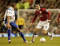 Photo: Aidan Ellis.<br /> Manchester United v Portsmouth. The FA Cup. 27/01/2007.<br /> United's Ryan Giggs takes on Pompey's Glenn Johnson