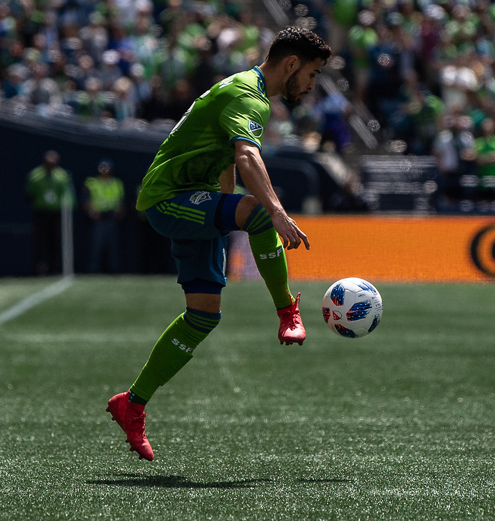May 05, 2018; Seattle, Washington, US;  Seattle Sounders midfielder Alex Roldan (16) controls the ball during in action between the Seattle Sounders FC and Columbus Crew at Century Link Field. Photo credit: Rick May - Rick May Photography