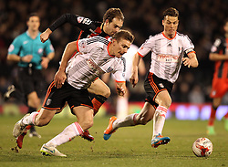 Bournemouth's Brett Pitman runs past Fulham's Tim Hoogland and Fulham's Scott Parker - Photo mandatory by-line: Robbie Stephenson/JMP - Mobile: 07966 386802 - 06/03/2015 - SPORT - Football - Fulham - Craven Cottage - Fulham v AFC Bournemouth - Sky Bet Championship