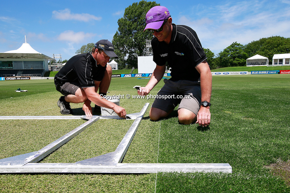 Hagley Oval groundsmen laying down the guides for painting the batting crease for the Blackcaps v Sri Lanka Boxing Day test match at Hagley Oval, Christchurch. 24 December 2014 Photo: Joseph Johnson / www.photosport.co.nz