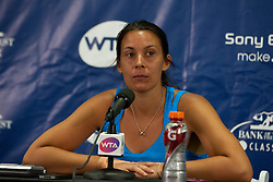 July 30, 2011; Stanford, CA, USA;  Marion Bartoli (FRA) addresses the media after winning her match against Dominka Cibulkova (SVK), not pictured, during the semifinals of the Bank of the West Classic women's tennis tournament at the Taube Family Tennis Stadium. Cibulkova retired with an injury before the match began.