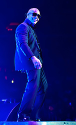 "LOS ANGELES, CA - OCT 11  American rapper and Latin Grammy winning artist Pitbull (Armando Christian Pérez) had the sold-out audience dancing from the floor to the rafters for the ""Sex and Love"" tour with Enrique Iglesias in Los Angeles, USA. 2014 Oct 11. Byline, credit, TV usage, web usage or linkback must read SILVEXPHOTO.COM. Failure to byline correctly will incur double the agreed fee. Tel: +1 714 504 6870."