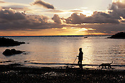 SUW sunset over beach with sillouette of man fishing Portpatrick
