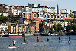 © Licensed to London News Pictures.  01/09/2017; Bristol, UK. Scenes around Bristol Docks on 1st September, the meteorological first day of the autumn season, with coloured houses in Cliftonwood, and paddle boarders. Picture credit : Simon Chapman/LNP