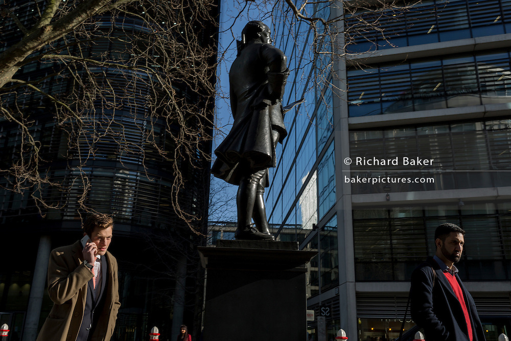 City Men beneath the statue of Member of parliament and Mayor John Wilkes (1727-1797) on 13th February 2017, in London, United Kingdom.