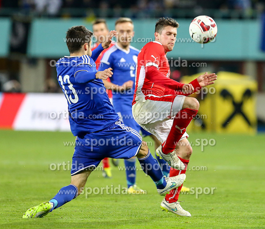 31.03.2015, Ernst Happel Stadion, Wien, AUT, Freundschaftsspiel, Oesterreich vs Bosnien Herzegowina, im Bild Mensur Mujdta (BiH) und Zlatko Junizovic (AUT) // during the friendly match between Austria and Bosnia and Herzegovina at the Ernst Happel Stadion, Vienna, Austria on 2015/03/31. EXPA Pictures © 2015, PhotoCredit: EXPA/ Alexander Forst