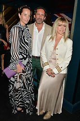 Left to right, JULIA BRANGSTRUP, MARK BRANGSTRUP WATTS and JO WOOD at a summer party hosted by Jo Wood & Yasmin Mills at Boujis, 43 Thurloe Street, London on 9th July 2014.