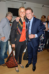 LADY BELLA SOMERSET and JOLYON FENWICK at a private view of photographs by Jolyon Fenwick 'The Zero Hours Panoramas' 100 Years On: Views From The Parapet of The Somme held at Sladmore Contemporary, 32 Bruton Place, London on 30th June 2016.