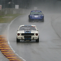 #94 Brian Kennedy in his 1966 Shelby GT350 battles #57 Pete Stolz in his 1973 Porsche 911 RSR in the rain during the The Hawk with Brian Redman held at Road America,  Elkhart Lake, WI. on July 21, 2013.