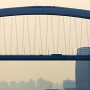 The lines of a bridge over the Huangpu River in Shanghai China.