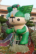 Tian'anmen Square (Place of Heavenly Peace). National Museum. Olympic mascots flower display. Nini the swallow.