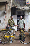 Shop owner and worker deliver paper throughout the city via utility bike - Bombay/Mumbai - India